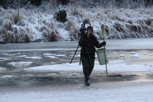 Director with camera on ice